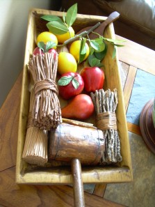 Nonna decorates an antique trough with lemons and rustic finds.