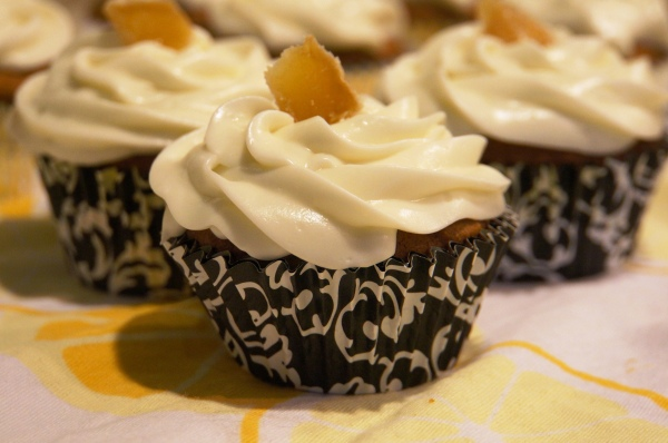 A perfectly moist pumpkin cake is topped off with lemony cream cheese frosting and a sliver of crystallized ginger.